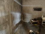 Remontés capillaires sur un mur intérieur de garage